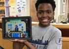 Student showing his ipad with his work on it